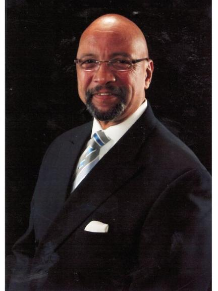 Rev. Kenneth H. Hill smiling profile picture